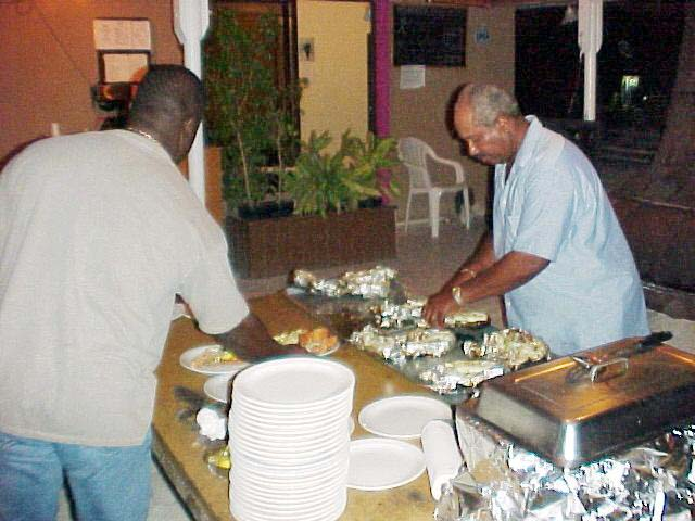 Lowell putting finishing touch on dinner, 2002